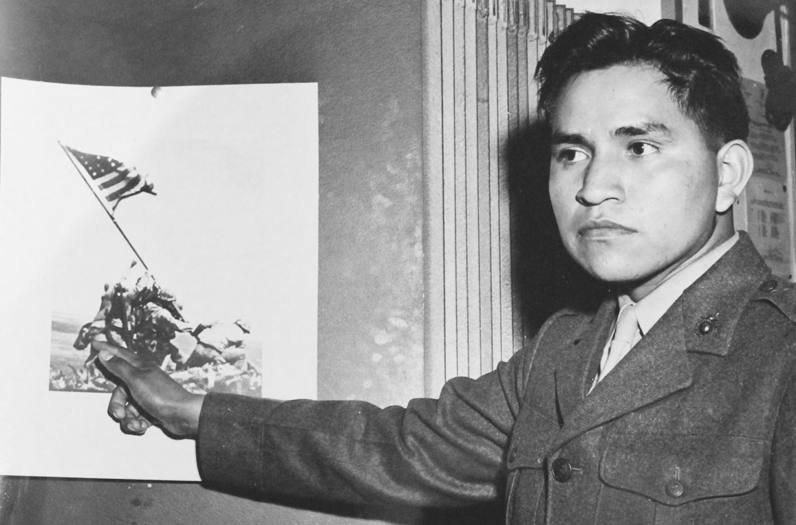 Ira Hayes Pointing To His Photograph From Iwo Jima