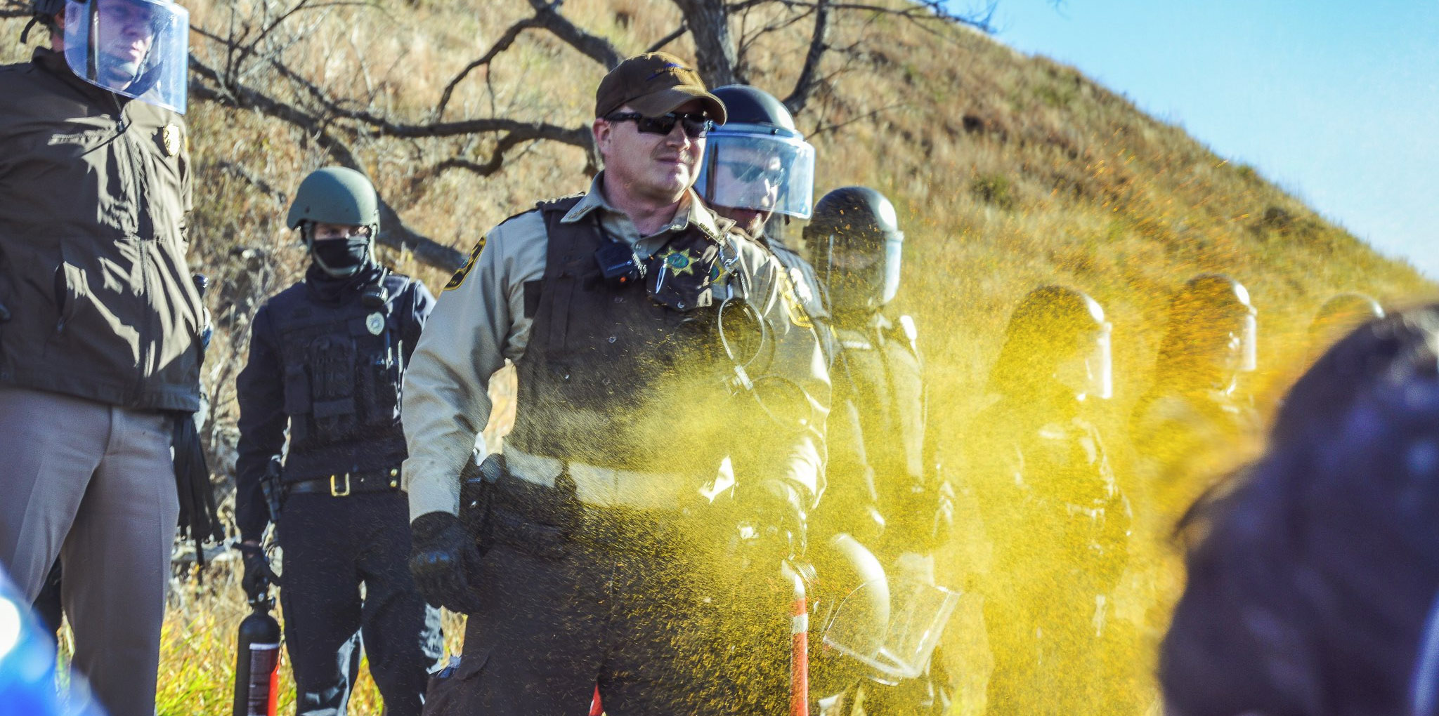 Morton County Police Deploying Tear Gas On A Group Of Indigenous Activists Engaged In Prayer © Rob Wilson Photography