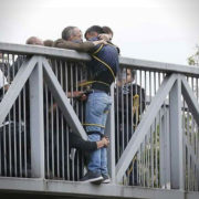 Strangers Hold Onto Man To Prevent Him From Jumping Off Bridge
